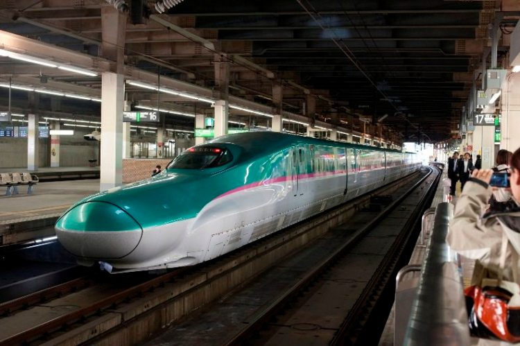 Hayabusa (Peregrine Falcon) or E5 shinkansen train at a rail station in Japan